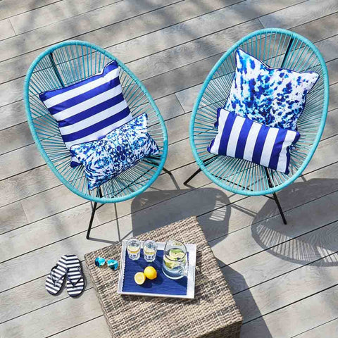 Outdoor Cushions in Mesmerise print with blue stripe reverse on garden chairs by Penelope Hope