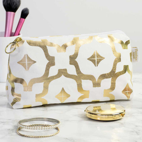 Taha'a White & Gold Makeup Bag by Penelope Hope