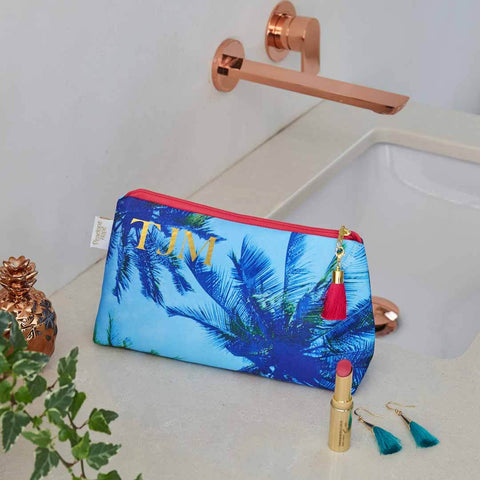 Personalised Palm Sky Blue Waterproof Makeup Bag by Penelope Hope