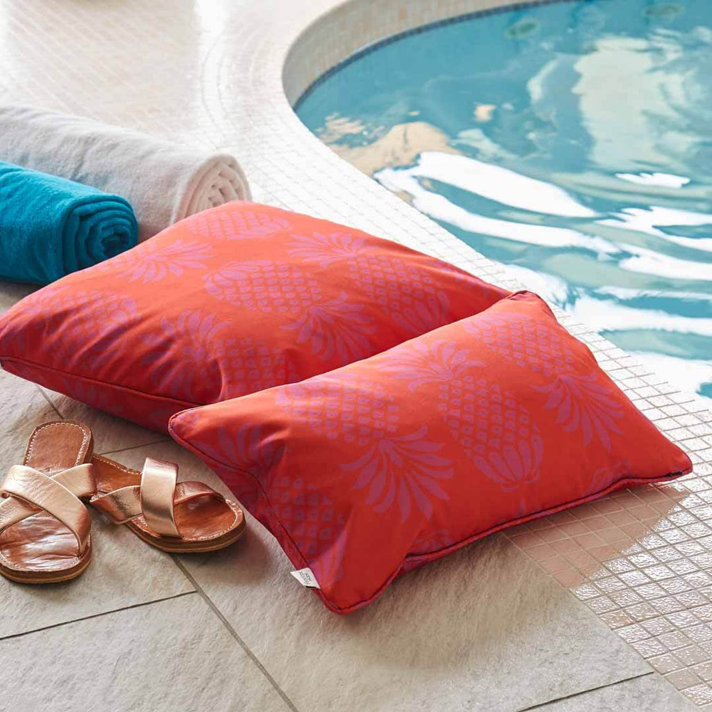 Red and Purple Pineapple Outdoor Cushion by Penelope Hope