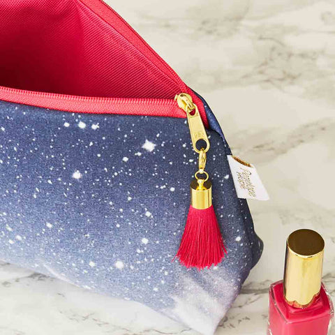 Cosmic Sky Wash Bag with Pink Tassel by Penelope Hope
