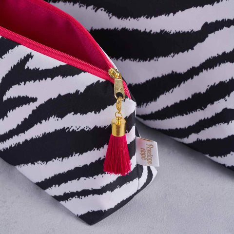 Black and White Zebra Print makeup bag with pink lining