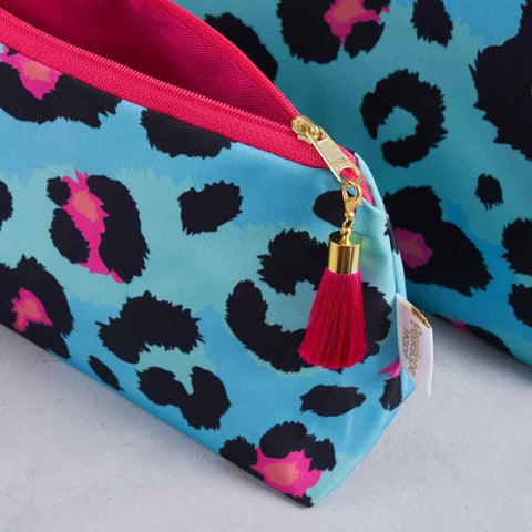 Teal Leopard Print makeup bag with pink lining