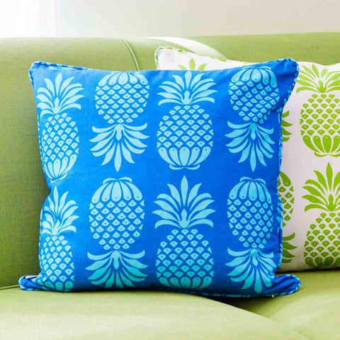 Blue Pineapple Cushion on sofa | Penelope Hope