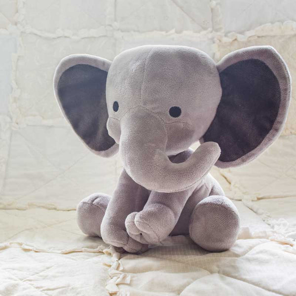 stuffed elephant on blanket