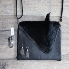 flatlay of black mooi hide bag, stella and gemma jewellery, from Hall Greytown