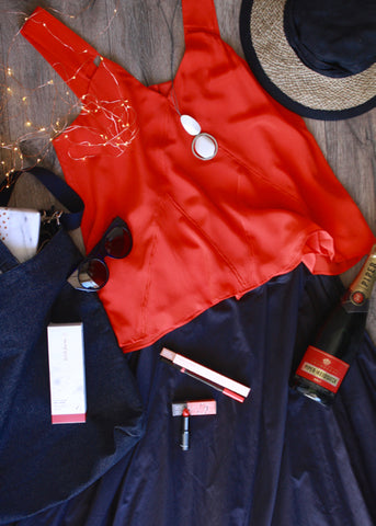 red singlet navy skirt