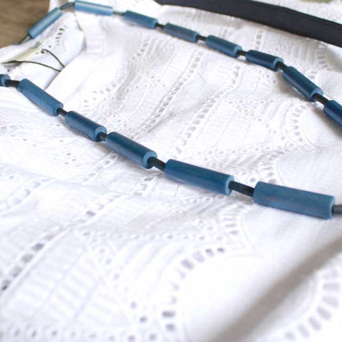 broderie anlgaise and wooden bead necklace