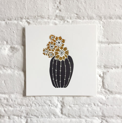 art print of a barrel cactus in black letterpress and gold foil