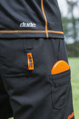 An image showing Dude Tech Caddie Shorts in black color with Left and right hand minidisc pockets