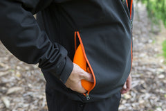 An image showing Dude Tech Caddy Jacket in black with Large welded side zips to stash up to 6 discs