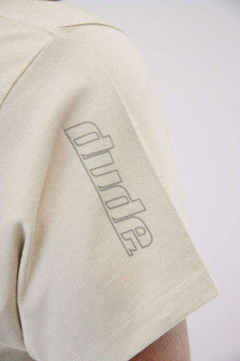 An image showing Arden Cotton Tee- Disc golf polo shirt sleeve.  Disc golf polo off white color