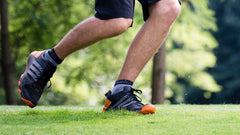 An image showing legs of a man running wearing  Reversible Unstinkable Socks from Dude Apparel.