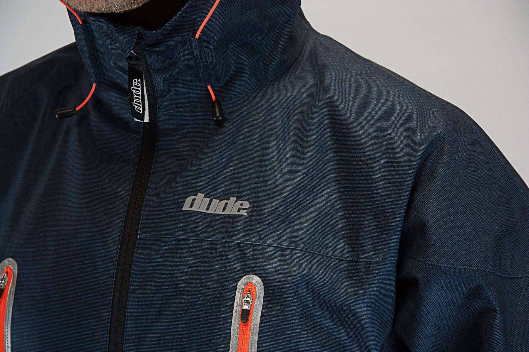 An image showing Dude Tech Caddy Jacket in black with logo
