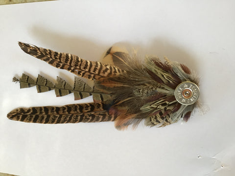 Pheasant feather hat pin.