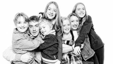 Julie and her family pictured together in a black and white photo