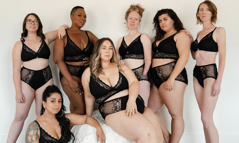 7 women in blacklace bras and pantiees