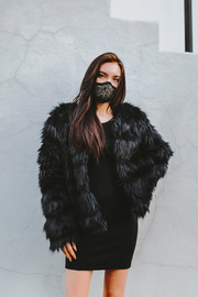 Woman wearing black/gold lace mask