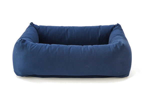 Bolster Bed, solid blue with navy ticking cushion