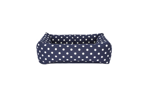 Bolster Bed, navy ikat dot with blue ticking cushion
