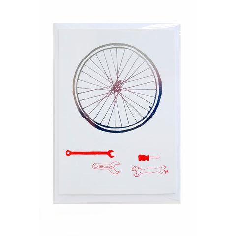 Cool card with bicycle wheel print and some tools by Kim Jenkins of Lucky Bird.