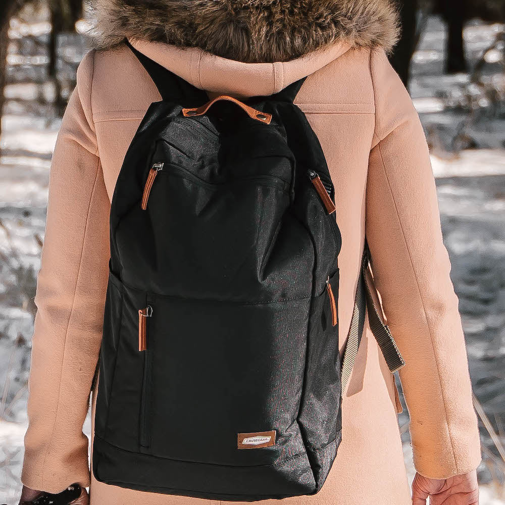 vintage canvas backpack. waterproof canvas backpack. canvas laptop backpack. large canvas backpack. 100recycled backpack. socially responsible backpacks. backpacks made from recycled materials. sustainable travel bag. book bags for college. backpacks for school. black.