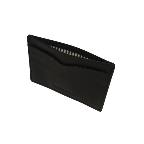 Handcrafted from eco-friendly leather card wallet that helps end human trafficking.