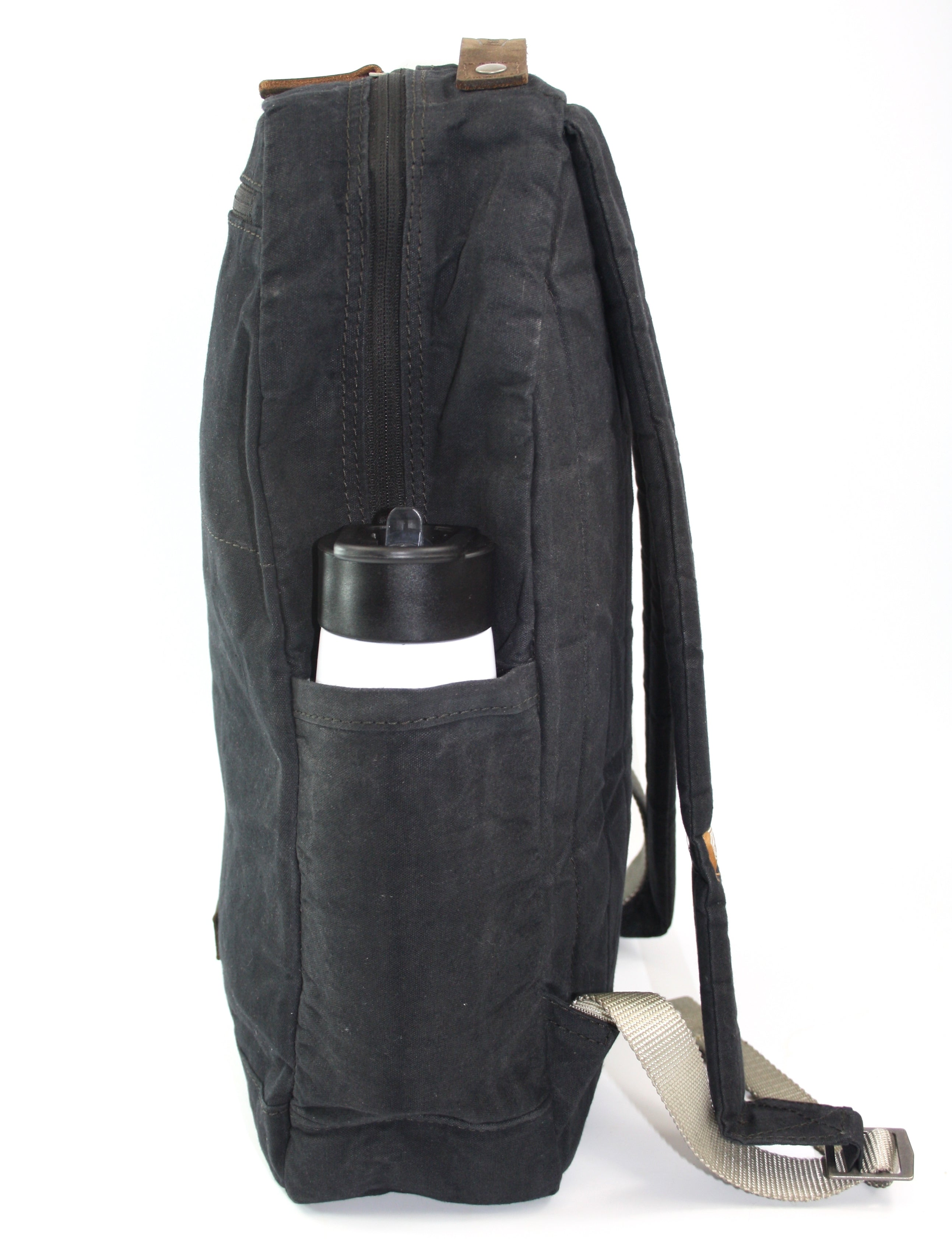 vintage canvas backpack. waterproof canvas backpack. canvas laptop backpack. large canvas backpack. 100recycled backpack. socially responsible backpacks. backpacks made from recycled materials. sustainable travel bag. book bags for college. backpacks for school.