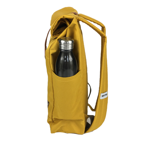 lightweight roll top backpack. best roll top backpack waterproof. canvas roll top bag. best roll top backpack. rolling backpacks. eco friendly roll top backpack. 100recycled backpack. socially responsible backpacks. backpacks made from recycled materials. sustainable travel bag. mustard.