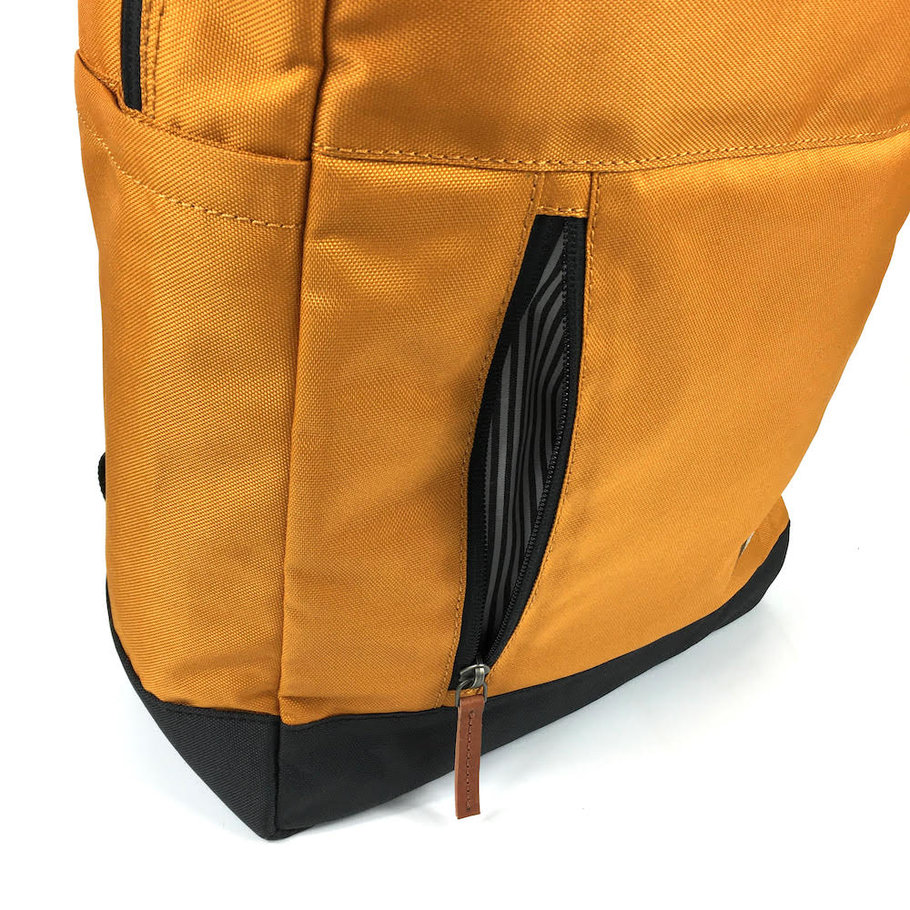 vintage canvas backpack. waterproof canvas backpack. canvas laptop backpack. large canvas backpack. 100recycled backpack. socially responsible backpacks. backpacks made from recycled materials. sustainable travel bag. book bags for college. backpacks for school. burnt orange.