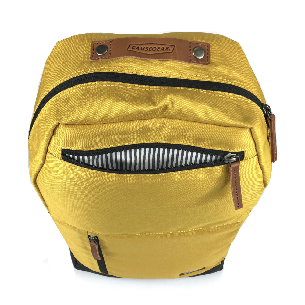 vintage canvas backpack. waterproof canvas backpack. canvas laptop backpack. large canvas backpack. 100recycled backpack. socially responsible backpacks. backpacks made from recycled materials. sustainable travel bag. book bags for college. backpacks for school. mustard.