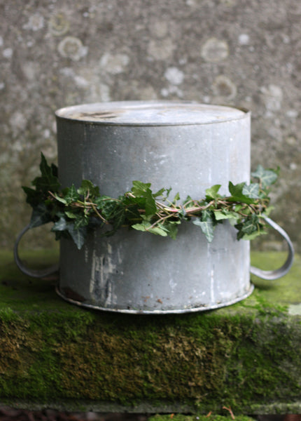 ivy wreath formed on upturned bucket
