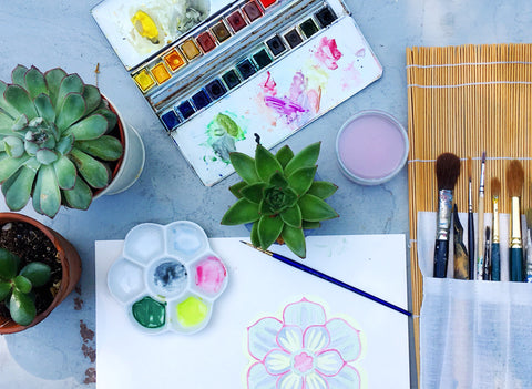 designing succulent placemats with watercolour paints in the garden