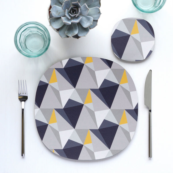 Shards geometric design table setting with placemat and coaster by Beyond the Fridge in Concrete and Yellow colour variation