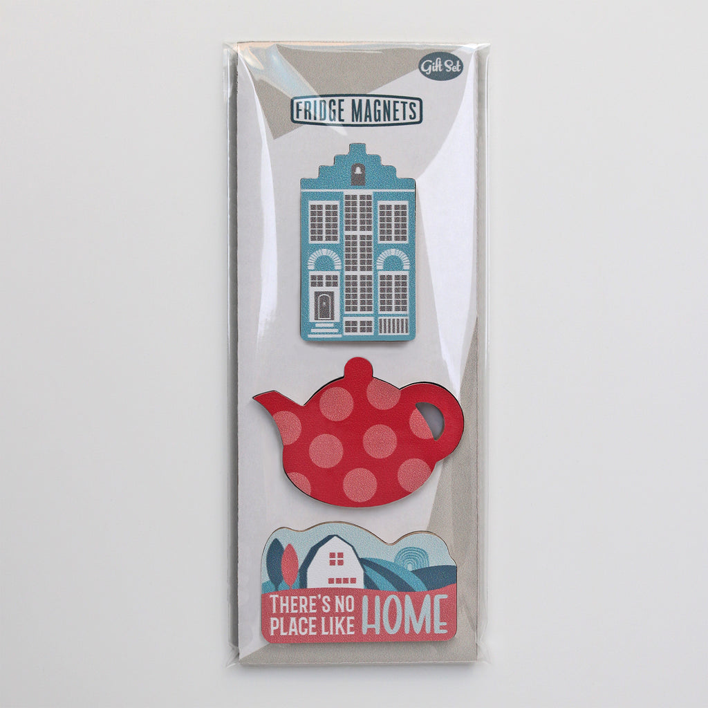 A gift set of the fridge magnets for new home owners including a Delft house, teapot and vintage sign magnet