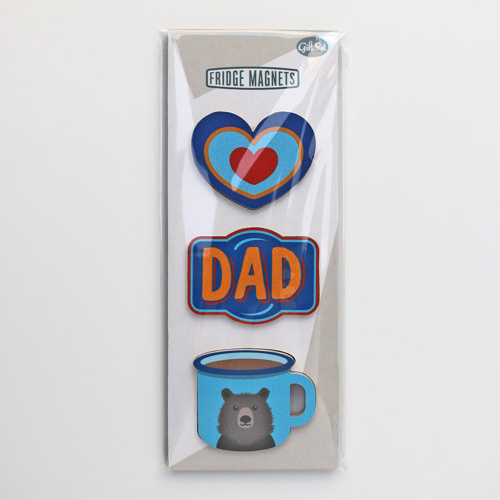 A gift set of three fridge magnets for dads. Including a heart design magnet, a dad vintage label and enamel mug with a bear on it.