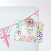 bunting design magnetic notice board with a postcard attached with a heart fridge magnet