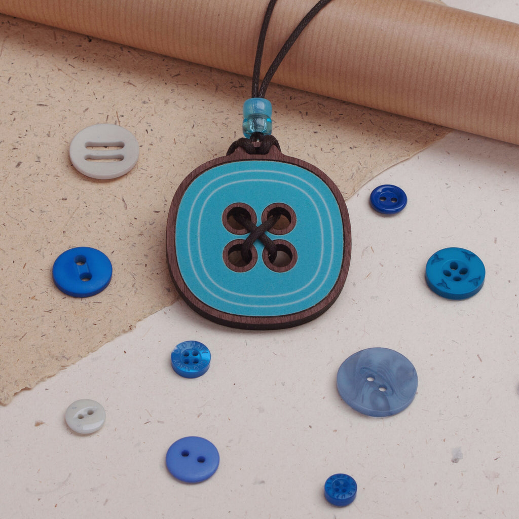 blue button design wooden pendant from beyond the fridge