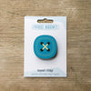 Blue button design fridge magnet on pack by Beyond the Fridge