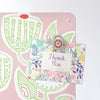 cupcake plant design magnetic notice board with a postcard attached with a watering can fridge magnet