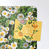 daisies design magnetic notice board with a postcard attached with a watering can fridge magnet