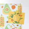 exotic fruit design magnetic notice board with a postcard attached with a lemon slice fridge magnet