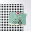 gingham design magnetic notice board with a postcard attached with a heart fridge magnet
