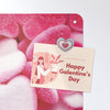 heart sweets design magnetic notice board with a postcard attached with a heart fridge magnet