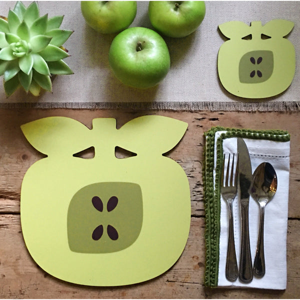 Golden delicious apple shaped placemat and coaster as part of a rustic table setting