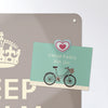 keep calm and carry on design magnetic notice board with a postcard attached with a heart fridge magnet