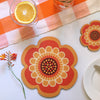 Orange retro flower power design placemat and coaster by Beyond the Fridge