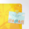 oranges and lemons design magnetic notice board with a postcard attached with a lemon slice fridge magnet