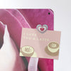 pink rose design magnetic notice board with a postcard attached with a heart fridge magnet