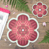 Flower shaped placemat and coaster with a succulent design in Maroon colour way by Beyond the Fridge